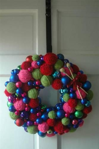She glued ornaments and yarn balls on a Styrofoam wreath form.