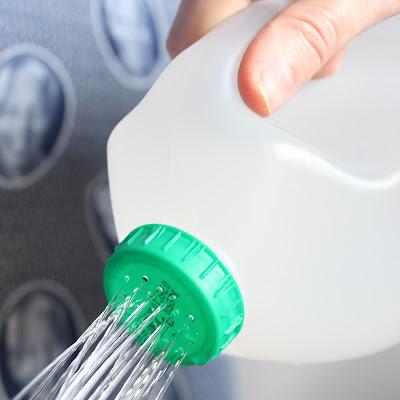 savvyhousekeeping 10 ways to recycle a milk jug watering can